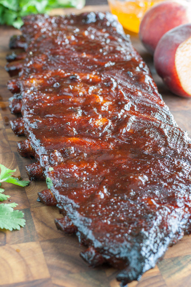 Peach Honey BBQ Ribs are tender, juicy and packed with flavor. They are easy to make so fire up the grill and get ready for some fall off the bone ribs.