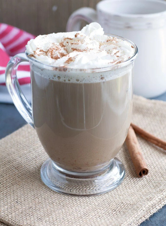 cinnamon roll latte topped with whipped cream