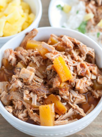 BBQ shredded pork with pineapple tidbits in a bowl.