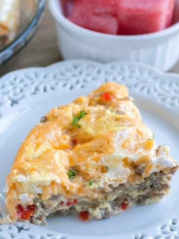 Piece of breakfast casserole on a plate.