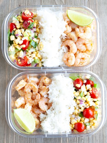Container with shrimp, rice and corn salsa.