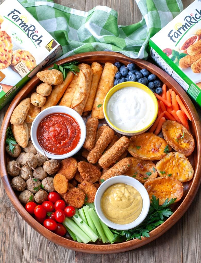 Platter with mozzarella sticks, meatballs, potato skins and fried pickles