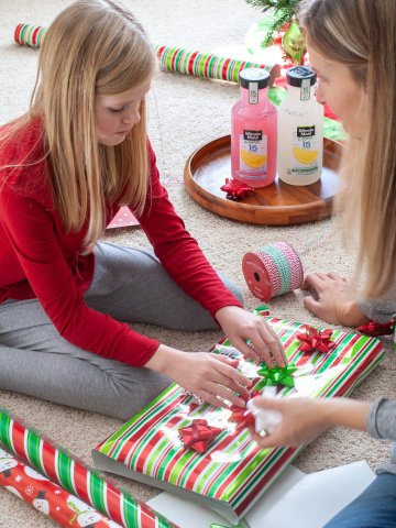 Girl wrapping present.