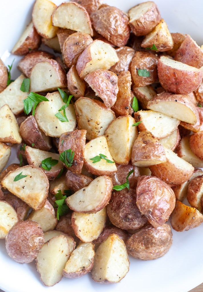 Bowl of roasted red potatoes with herbs