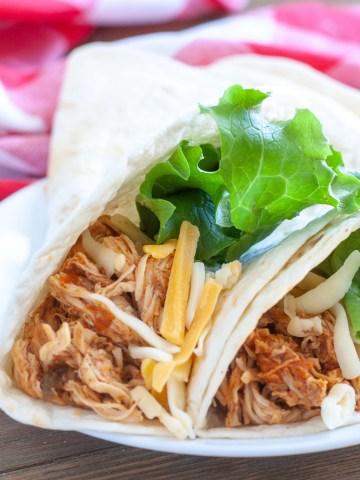 Shredded chicken in tortilla shell.