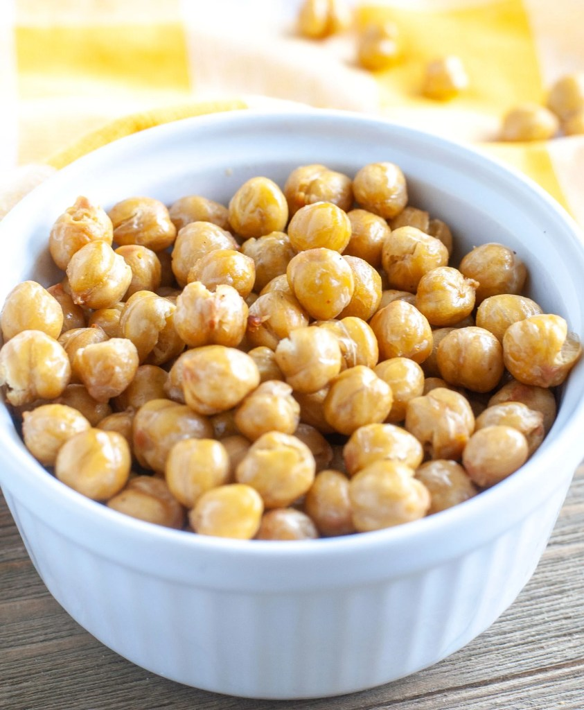 roasted chickpeas in a white bowl with yellow towl