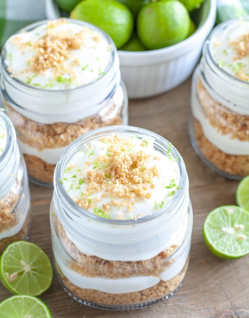 Key Lime trifles in little jars. Bowl of key limes