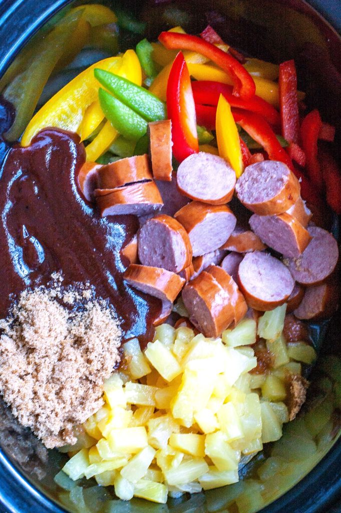 Peppers, kielbasa, pineapple, BBQ sauce and brown sugar in a crockpot