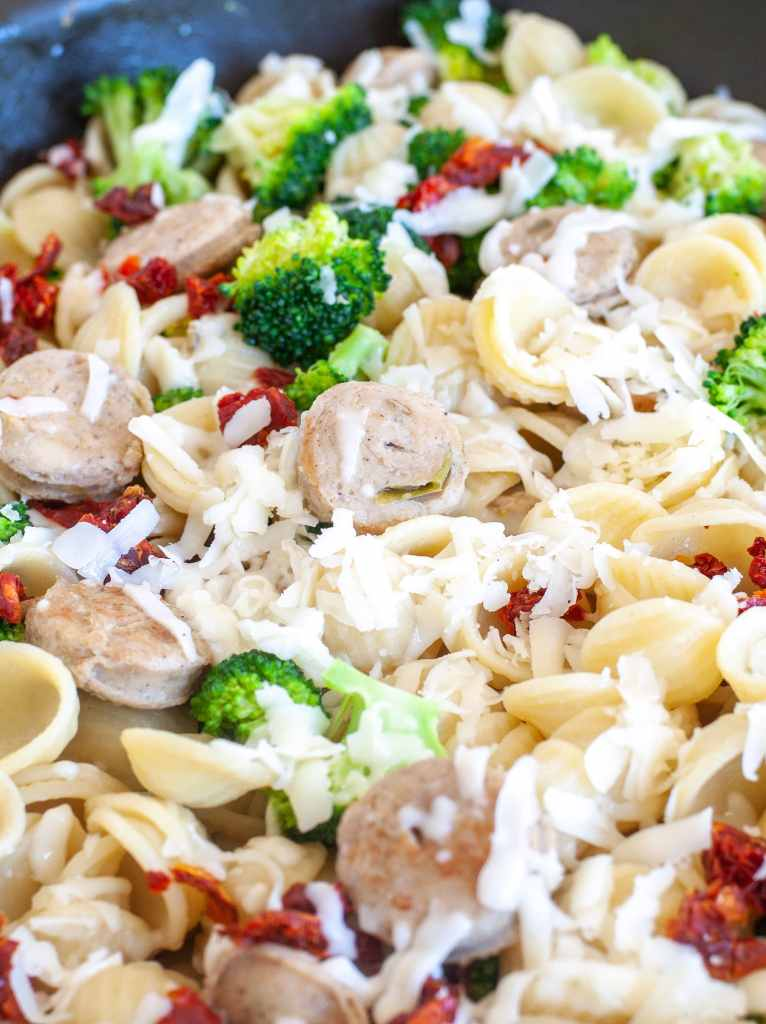 Orecchiette with chicken sausage and broccoli in a skillet