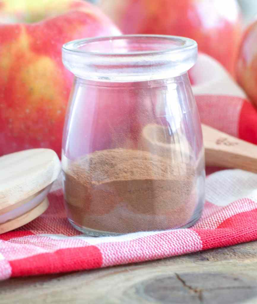 Apple Pie Spice in a jar on a red napkin