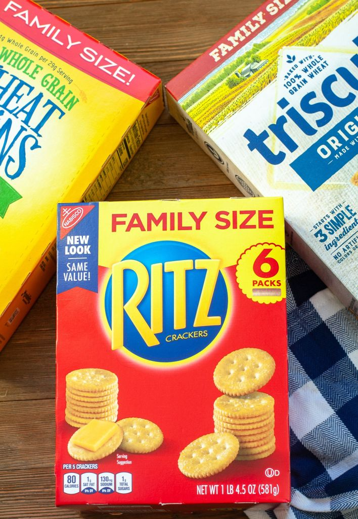 A box of Ritz Crackers, triscuit and wheat thins