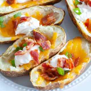 Plate of loaded potato skins make in the air fryer.