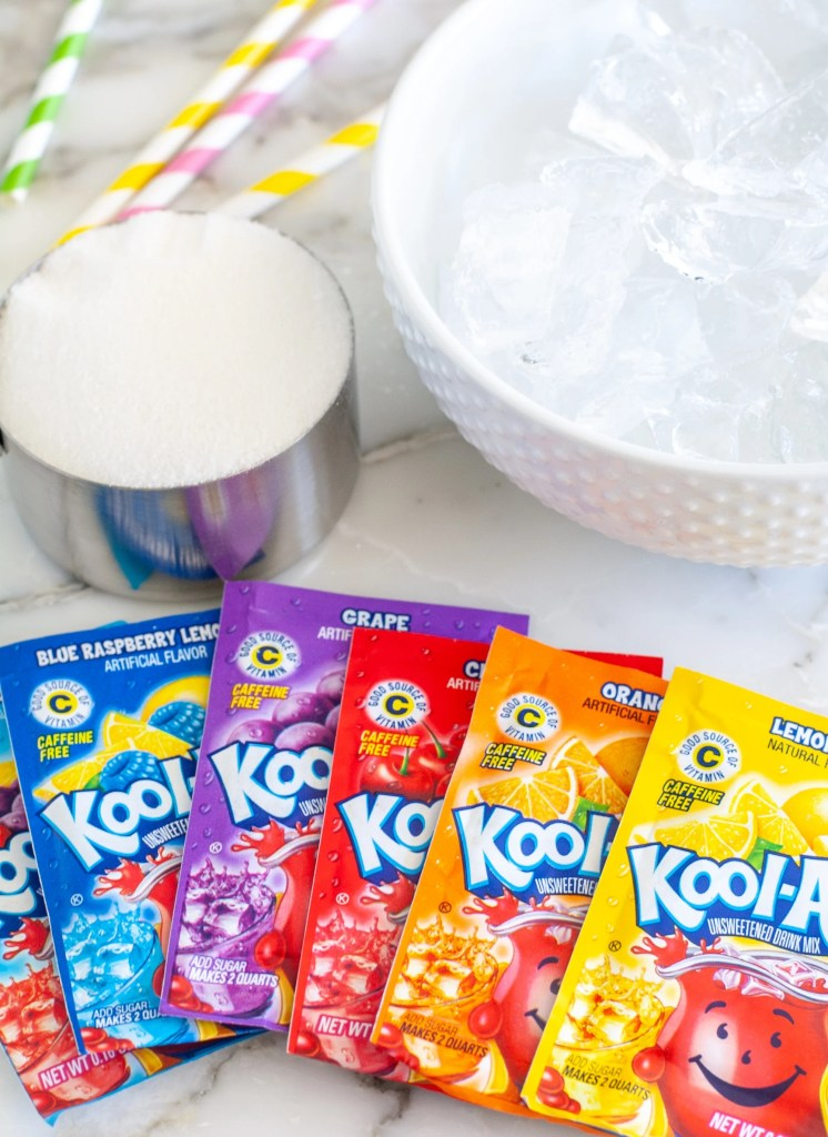 Packets of Kool-Aid, Ice in bowl and sugar