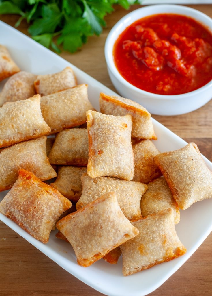 pizza rolls on plate with marinara sauce