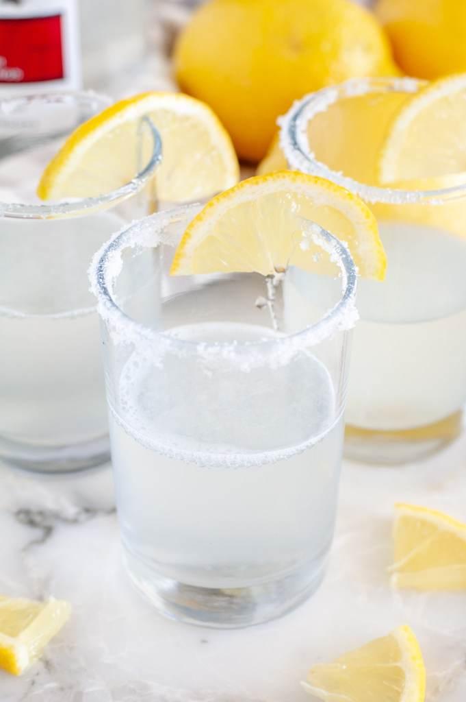 Lemon Drop Shot in shot glass with lemon wedge