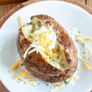 Baked potato with cheese and sour cream