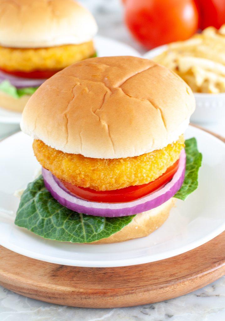 Chicken sandwich on plate.