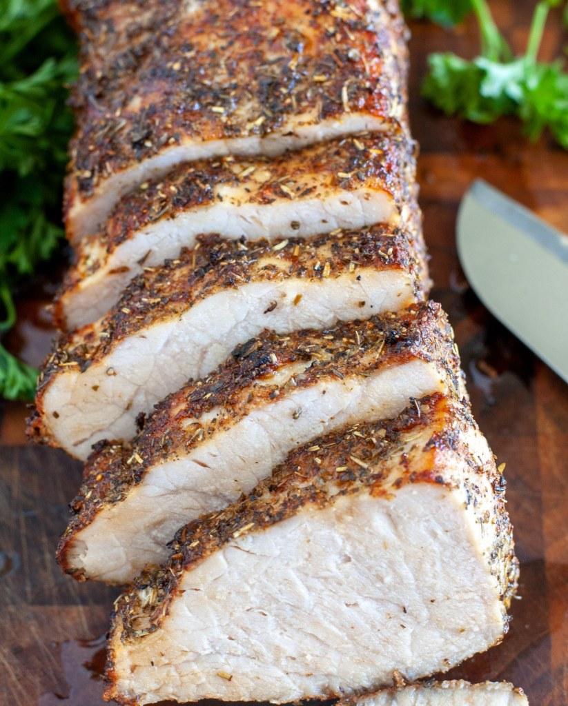 Sliced pork loin on cutting board.