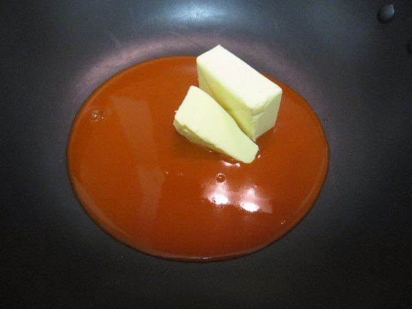 A Pan of Franks Hot Buffalo Wing Sauce and Unmelted Butter