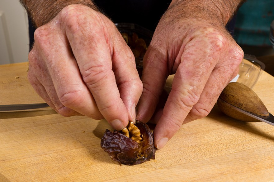 David Jackson stuffing walnuts into medjool dates on Food Over 50