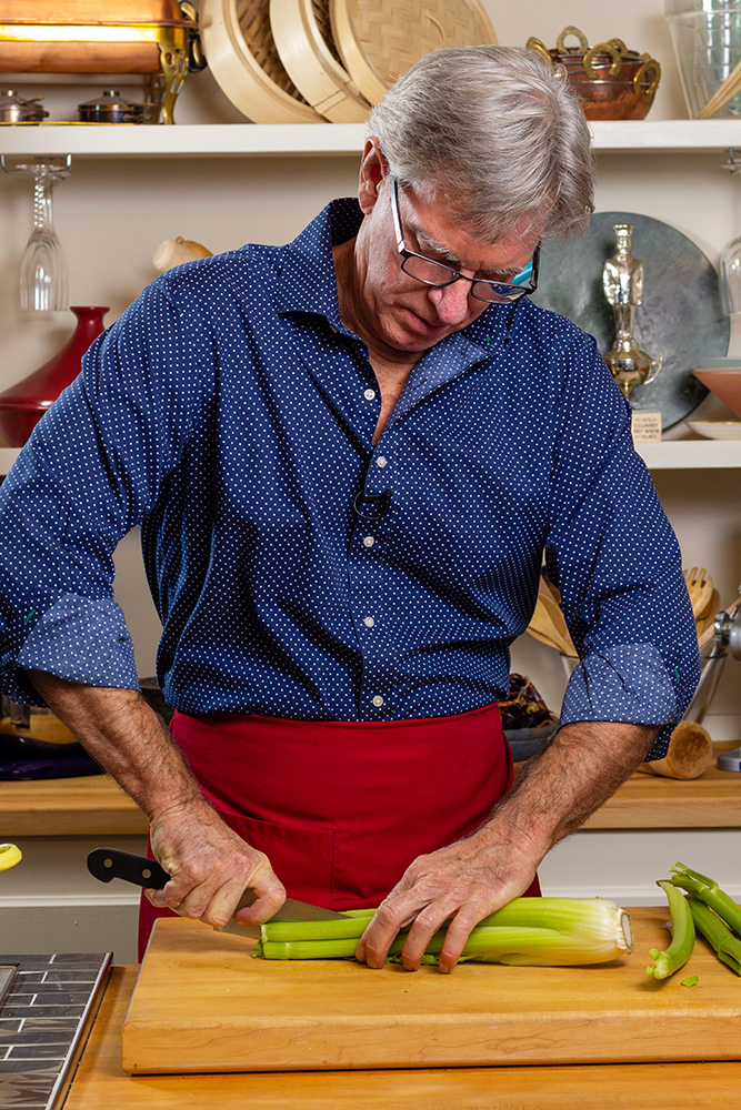 David Jackson preps celery for the Almost chicken soup recipe