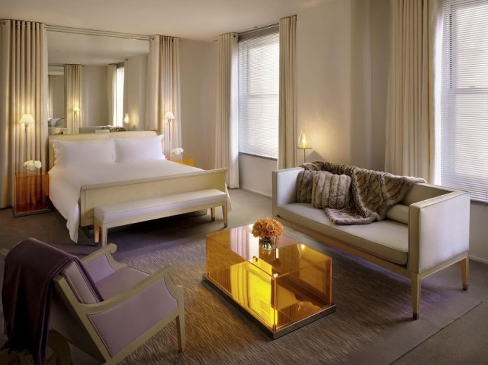 Rooms at the Clift feature Philippe Starck-designed English sycamore sleigh beds, dressed in crisp white 300-thread-count sheets. (Courtesy of Morgans Hotel Group)