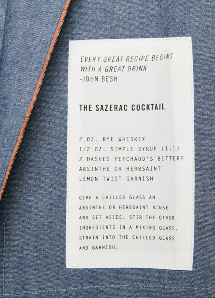 Flip over the apron, and you'll discover a Sazerac recipe and a quote by Besh that rings true to many home cooks. (Photo credit: Billy Reid)