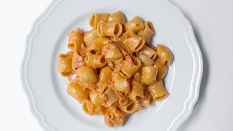 Carbone's Spicy Vodka Rigatoni features tender pasta knobs enrobed in a silky sauce of crushed tomatoes, Parmesan, cream, vodka, and chili flakes. (Photo courtesy of Carbone.)