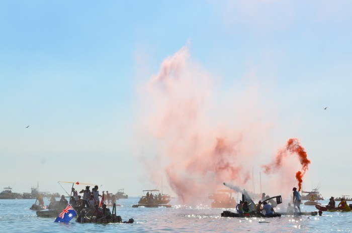 Boats fire water balloons and fire extinguishers at each in search of buried treasure.