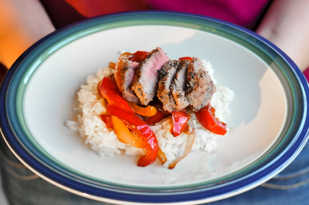 Pan Roasted Ribeye with Stir Fry Bell Peppers and Onions over Rice