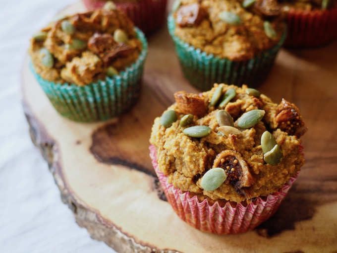 Paleo Pumpkin Fig Muffins on a pretty slab of wood with white table cloth
