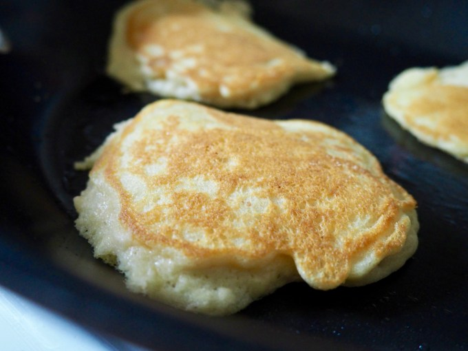 baking with coconut flour panckes in a pan