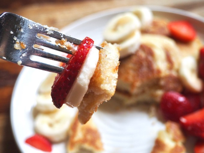 baking with coconut flour forkfull of pancakes with strawberry and banana