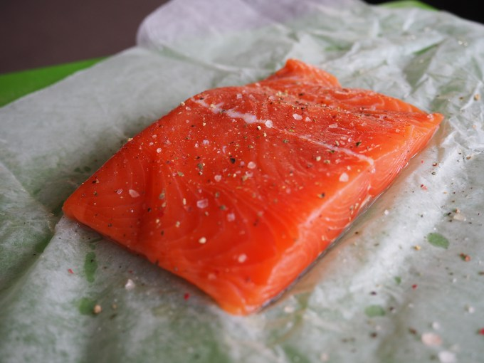 fresh raw wild salmon with flaked sea salt and ground pepper