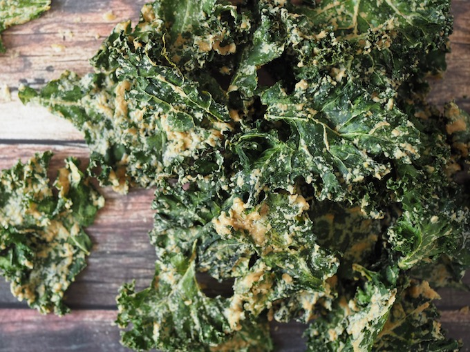 pile of Easy Tahini Garlic Kale Chips on a wooden table