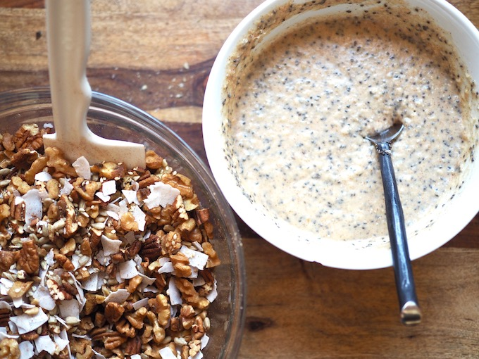 bowl of nuts, seeds, and coconut next to bowl of applesauce, chia seeds, and coconut oil