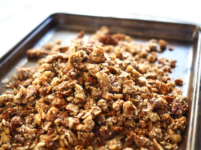 a pile of tasted golden brown cinnamon crunch grain-free granola on a pan