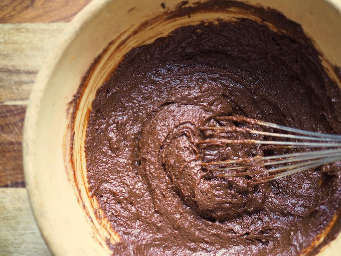 fudgy Tahini Pumpkin Paleo Brownies batter in ceramic bowl