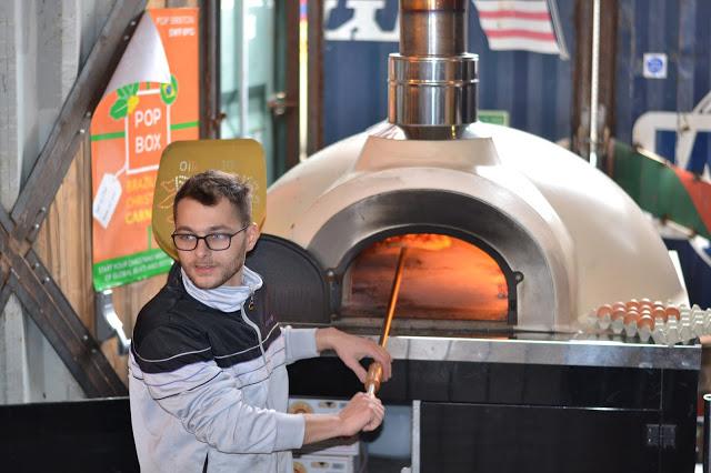 A pizzaiolo making pizza