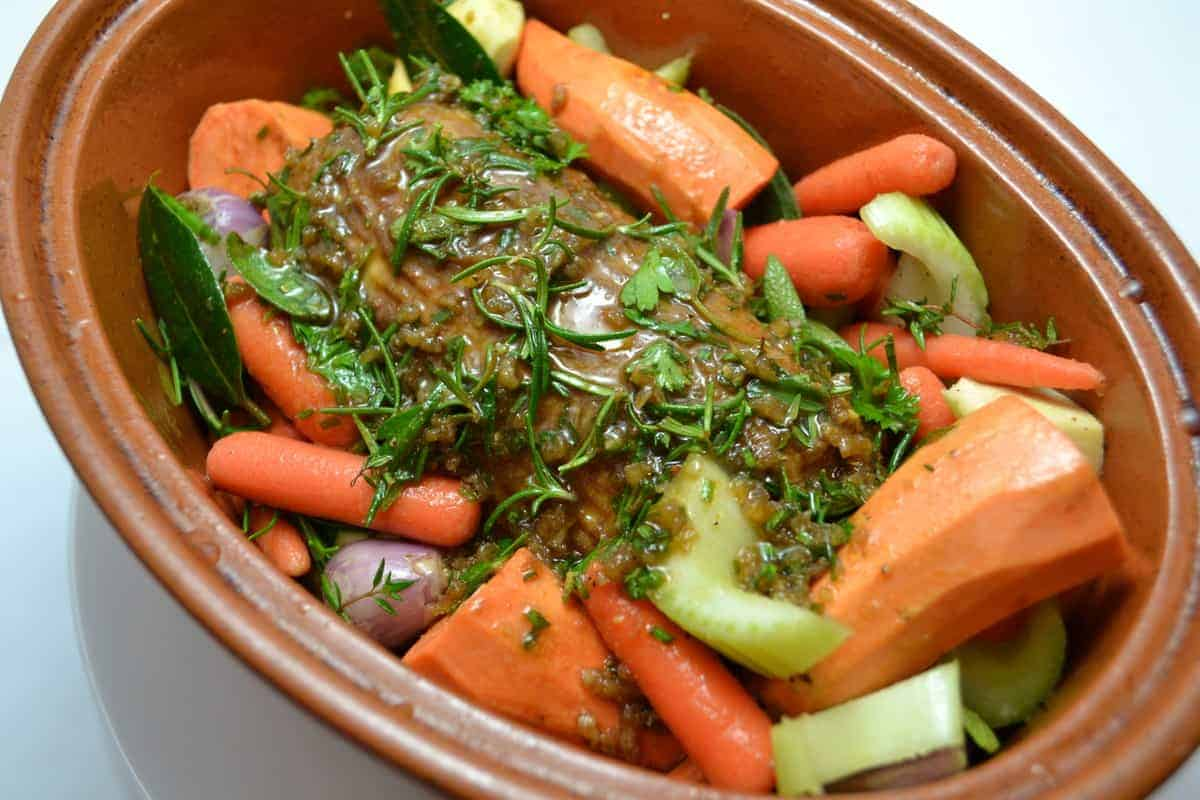 Here's how the marinaded roast looks with the shallots, carrots, celery, and sweet potatoes in my clay pot