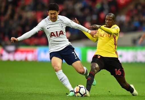 Abdoulaye Doucoure tackles Heung-Min Son at Wembley