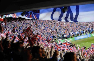 Rangers fans wave flags during half-time in the UEFA Cup Final soccer match against Zenit St. Petersburg at the City of Manchester stadium in Manchester