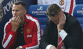 United Coach Louis Van Gaal and assistant Ryan Giggs looking ... ???
