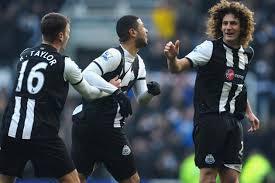 Newcastle captain Fabricio Coloccini and Ryan Taylor