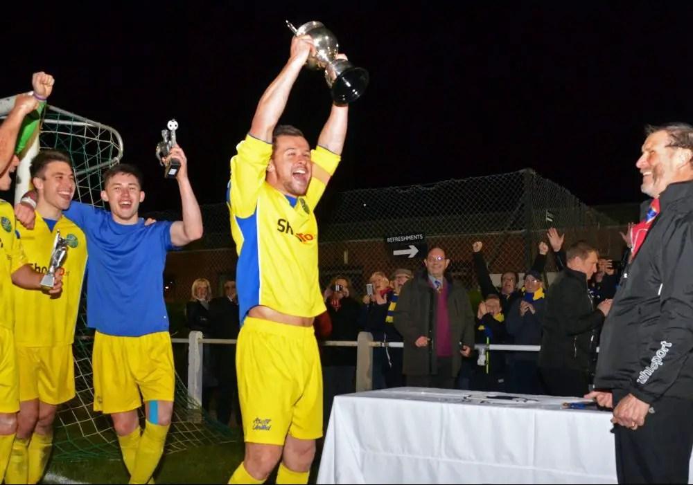 Ascot United captain Dave Hancock lifts the Floodlit Cup. Photo: Mark Pugh.