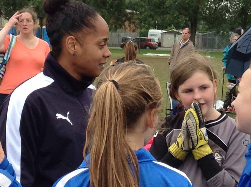 Reading FC Women's Jade Boho Sayo with Bracknell girls at the Westwood Wanderers tournament. Photo: Lara Johnson.