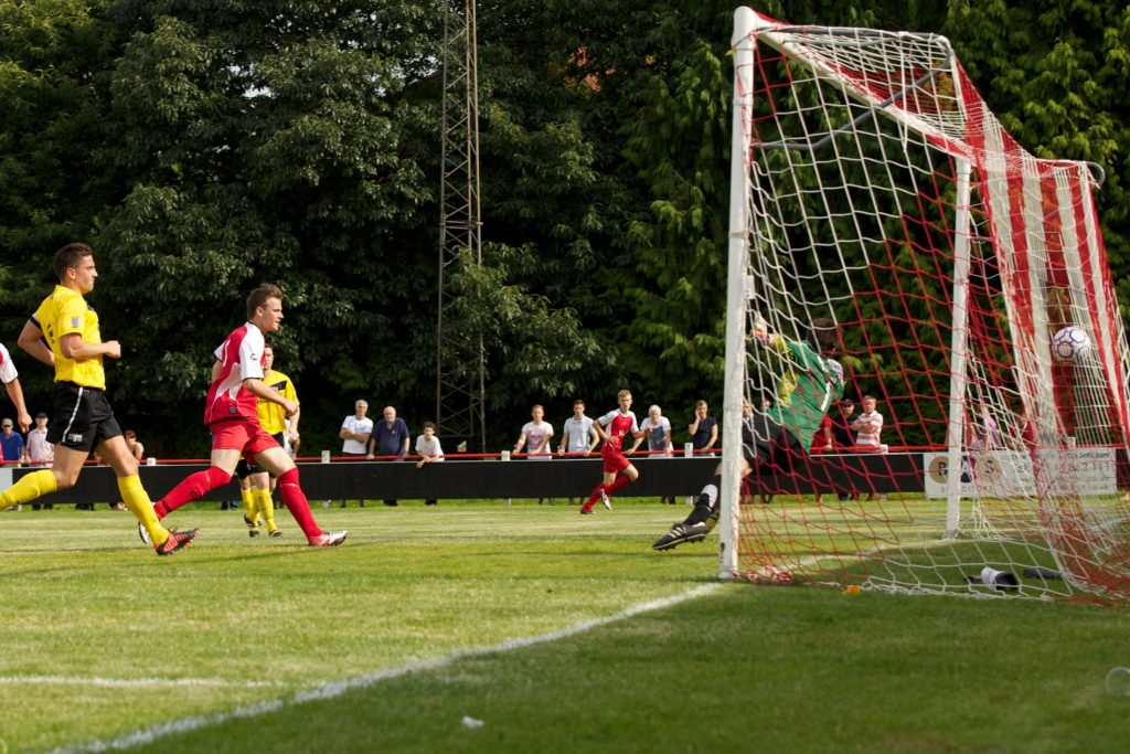 Tom Barratt scores for Bracknell Town in the FA Cup against Binfield.