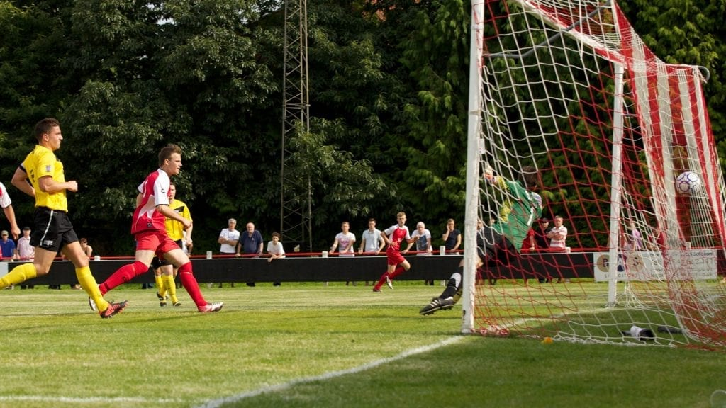 Sam Barratt (far side) crosses for brother Tom Barratt to score the winner for Bracknell Town in the FA Cup against Binfield. Photo: Ben Temple.