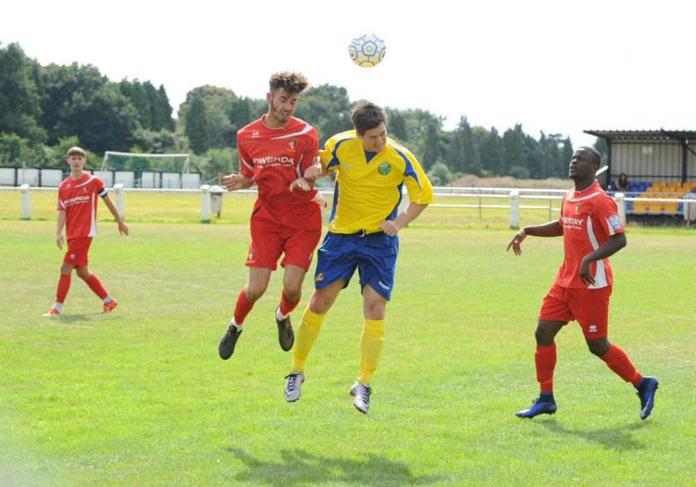 Ben Knight challenges in the air for Ascot United. Photo: Mark Pugh.
