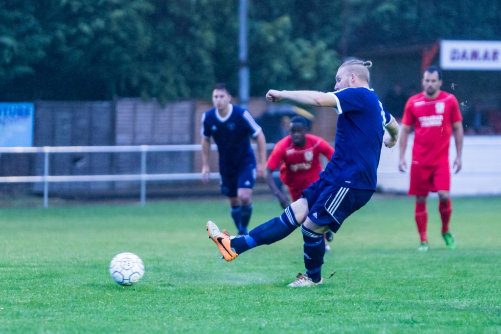 Callum Whitty scores a penalty for Bracknell Town at Flackwell Heath. Photo: Neil Graham.